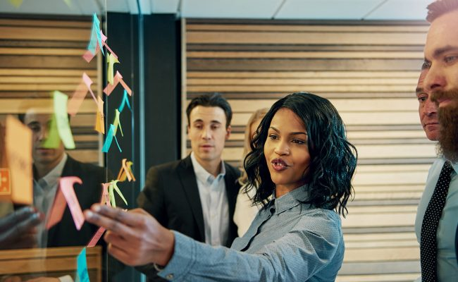 Black business woman in front of business team